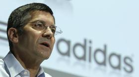 CEO of German sporting goods maker Adidas Herbert Hainer speaks during the company's annual news conference in the northern Bavarian town of Herzogenaurach March 7, 2012.      REUTERS/Michaela Rehle
