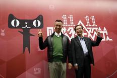 Alibaba Group CEO Jonathan Lu (L) and Alibaba Group COO Daniel Zhang pose for a photo at the company's headquarters in Hangzhou, Zhejiang province November 11, 2014. REUTERS/Aly Song