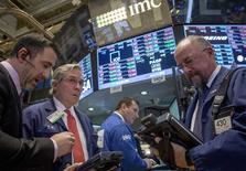 La Bourse de New York a fini pratiquement inchangée mardi, marquant une pause après les nouveaux records historiques inscrits en séance par plusieurs indices phares. Le Dow Jones a gagné 0,01% et le S&P-500 0,07%, tandis que le Nasdaq a avancé de 0,19%. /Photo prise le 11 novembre 2014/REUTERS/Brendan McDermid