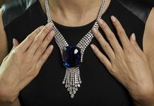 """REFILE - CORRECTING AUCTION HOUSE A Christie's staff member wears """"The Blue Belle of Asia"""", a 392,52 carats sapphire, in this file picture taken during an auction preview in Geneva November 6, 2014. REUTERS/Denis Balibouse/Files"""