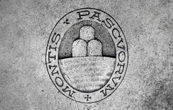 Banca Monte dei Paschi di Siena, lanterne rouge des tests de résistance du secteur bancaire européen le mois dernier, a publié mercredi une perte trimestrielle supérieure aux attentes, conséquence d'une forte augmentation de ses provisions pour créances douteuses. /Photo prise le 5 novembre 2014/REUTERS/Giampiero Sposito
