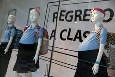 Mannequins of pregnant schoolgirls are seen in a shop window at a shopping mall in Caracas November 12, 2014.  REUTERS/Carlos Garcia Rawlins