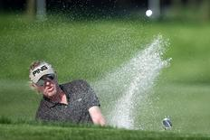 Miguel Angel Jimenez of Spain hits out of a bunker on the second hole during the second round of the WGC-HSBC Champions golf tournament in Shanghai November 7, 2014. REUTERS/Aly Song
