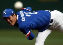 South Korea's starting pitcher Kim Kwang-hyun throws the ball against Taiwan in the first inning of their baseball game final at Munhak Baseball Stadium during the 17th Asian Games in Incheon September 28, 2014. REUTERS/Issei Kato