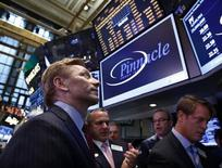 Pinnacle Foods Inc. CEO Bob Gamgort, (L) watches his company trade, following its IPO on the floor of the New York Stock Exchange, March 28, 2013.  REUTERS/Brendan McDermid