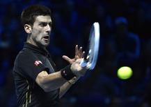 Novak Djokovic of Serbia returns the ball during his semi-final tennis match against Kei Nishikori of Japan at the ATP World Tour finals at the O2 Arena in London November 15, 2014. REUTERS/Toby Melville