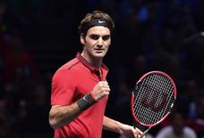 Roger Federer of Switzerland celebrates winning his semi-final tennis match against compatriot Stanislas Wawrinka at the ATP World Tour Finals at the O2 Arena in London November 15, 2014. REUTERS/Toby Melville