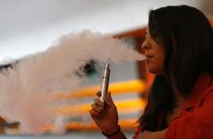 Enthusiast Brandy Tseu uses an electronic cigarette at The Vapor Spot vapor bar in Los Angeles, California March 4, 2014. REUTERS/Mario Anzuoni