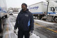 Freight driver Antoine Seegars looks up to talk with a fellow driver at the Con-way Freight trucking yard in Romulus, Michigan, November 19, 2014. COLDSNAP  REUTERS/Rebecca Cook