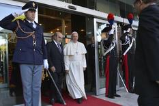 Pope Francis walks with U.N. Food and Agriculture Organization (FAO) Director-General Jose Graziano da Silva as he leaves at the end of a meeting at the FAO headquarters in Rome November 20, 2014. REUTERS/Andreas Solaro/Pool