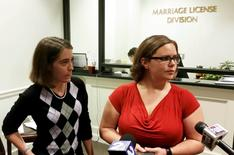 Jennifer Rose, (L), a county government employee and Sara Meadows, a teacher, file a marriage license application in Charleston, South Carolina October 9, 2014 , days after the U.S. Supreme Court struck down gay marriage bans in other states. REUTERS/Harriet McLeod