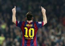 Barcelona's Lionel Messi celebrates his goal against Sevilla during their Spanish first division soccer match at Nou Camp stadium in Barcelona November 22, 2014.    REUTERS/Gustau Nacarino