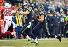 Nov 23, 2014; Seattle, WA, USA; Seattle Seahawks tight end Luke Willson (82) carries the ball against the Arizona Cardinals during the second half at CenturyLink Field. Seattle defeated Arizona 19-3. Mandatory Credit: Steven Bisig-USA TODAY Sports