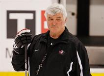 Canada's head coach Pat Quinn watches his team's practice at the 2009 IIHF U20 World Junior Hockey Championships in Ottawa, in this file photo from January 4, 2009. REUTERS/Shaun Best/Files