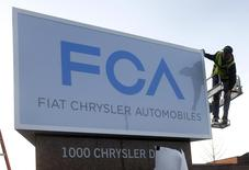 A new Fiat Chrysler Automobiles sign is unveiled at Chrysler Group World Headquarters in Auburn Hills, Michigan in this file photo taken May 6, 2014.  REUTERS/Rebecca Cook