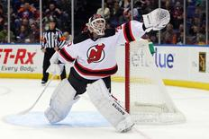 Mar 1, 2014; Uniondale, NY, USA; New Jersey Devils goalie Martin Brodeur (30) makes a save against the New York Islanders during the second period of a game at Nassau Veterans Memorial Coliseum. Mandatory Credit: Brad Penner-USA TODAY Sports
