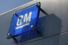 The General Motors logo is seen outside its headquarters at the Renaissance Center in Detroit, Michigan in this file photograph taken August 25, 2009.  REUTERS/Jeff Kowalsky/Files