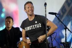 """Chris Martin wears a shirt that says """"SUBSTITU2"""" as he performs, in place of Bono, with U2 during a surprise concert in support of World AIDS Day in Times Square in New York December 1, 2014. REUTERS/Carlo Allegri"""