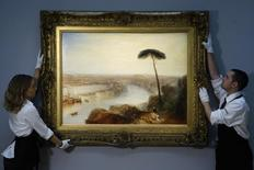 """Sotheby's employees pose with British artist J.M.W. Turner's artwork """"Rome, from Mount Aventine"""" at Sotheby's auction house in London November 28, 2014. REUTERS/Luke MacGregor"""
