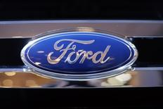 A Ford logo is seen on a car during a press preview at the 2013 New York International Auto Show in New York, March 28, 2013.   REUTERS/Mike Segar