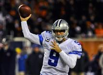 Dallas Cowboys quarterback Tony Romo (9) throws in the first half of their game against the Chicago Bears at Soldier Field. Mandatory Credit: Matt Marton-USA TODAY Sports