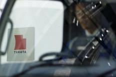 A logo of Takata Corp is seen through a car window outside the company's headquarter building in Tokyo April 12, 2013. REUTERS/Yuya Shino