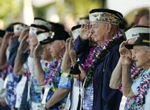 Louis Conter (3rd R in blue jacket), a USS Arizona survivor, and other Pearl Harbor survivors salute as the USS Chung-Hoon passes by during ceremonies honoring the 73rd anniversary of the attack on Pearl Harbor at the World War II Valor in the Pacific National Monument in Honolulu, Hawaii December 7, 2014.  REUTERS/Hugh Gentry