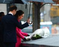Prince William and Catherine, Duchess of Cambridge, visit the National September 11 Memorial and Museum during their official Royal Visit to the United States in New York December 9, 2014. REUTERS/Robert Sabo/Pool