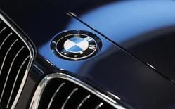 A BMW logo is pictured before the annual news conference of German premium automaker BMW in Munich March 19, 2014. REUTERS/Michaela Rehle