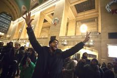 """A protester holds his hands up and chants """"Hands up, don't shoot"""" during a protest to demand justice for the death of Eric Garner, at Grand Central Terminal in the Manhattan borough of New York, December 9, 2014.  REUTERS/Carlo Allegri"""