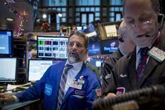 Traders work on the floor of the New York Stock Exchange December 10, 2014. REUTERS/Brendan McDermid