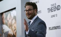 "Director, writer and cast member Seth Rogen waves at the premiere of ""This Is the End"" at the Regency Village Theatre in Los Angeles, California June 3, 2013. REUTERS/Mario Anzuoni"