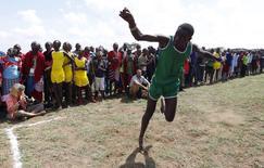 Tipape Lekatoo, an 18-year-old Maasai moran, throws a javelin during the Maasai Olympics 2014 at the Sidai Oleng wildlife sanctuary at the base of Mt. Kilimanjaro near the Kenya-Tanzania border in Kajiado December 13, 2014. REUTERS/Thomas Mukoya