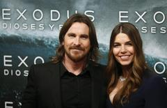"""Cast member Christian Bale (L) and his wife Sibi Blazic pose for photographs as they arrive for the film world premiere of """"Exodus: Gods and Kings"""" in Madrid , December 4, 2014. REUTERS/Juan Medina"""