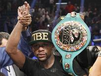 WBC/WBA welterweight champion Floyd Mayweather Jr. of the U.S. celebrates his victory over Marcos Maidana of Argentina at the MGM Grand Garden Arena in Las Vegas, Nevada September 13, 2014. REUTERS/Steve Marcus
