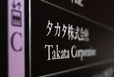 Takata Corp's company plate is seen at an entrance of the building where Takata Corp headquarters is located at in Tokyo December 9, 2014. REUTERS/Yuya Shino