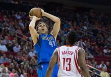 Nov 22, 2014; Houston, TX, USA; Dallas Mavericks forward Dirk Nowitzki (41) shoot over Houston Rockets guard James Harden (13) during the second half at the Toyota Center. The Rockets defeated the Mavericks 95-92. Jerome Miron-USA TODAY Sports