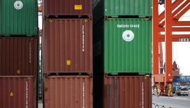 Workers are seen in a container area at a port in Tokyo September 18, 2014. REUTERS/Toru Hanai