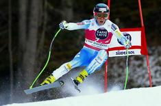 Steven Nyman of the U.S. clears a gate during the men's World Cup Downhill skiing race in Val Gardena December 19, 2014. REUTERS/Stefano Rellandini