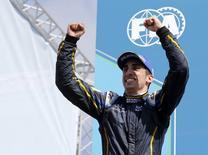 E.Dams-Renault driver Sebastien Buemi celebrates at the podium after winning round three of the Formula E championship in Punta del Este December 13, 2014. REUTERS/Andres Stapff