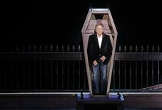 "Polish-French film director Roman Polanski stands inside a coffin as he takes part in the presentation of the musical ""Le Bal des Vampires"" (Dance of the Vampires) at the Mogador theater in Paris March 17, 2014. REUTERS/Jacky Naegelen"