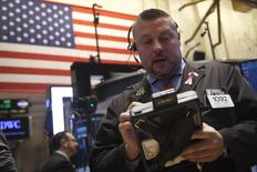 A trader works on the floor of the New York Stock Exchange in New York December 30, 2014.   REUTERS/Carlo Allegri