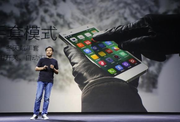 Lei Jun, founder and chief executive officer of China's mobile company Xiaomi Inc, introduces the new features of Xiaomi Phone 4 at its launching ceremony, in Beijing, July 22, 2014. REUTERS/Jason Lee/Files