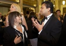 """Nominated British authors Ali Smith (L), who wrote """"How to be Both"""" and Neel Mukherjee, who wrote """"The Lives of Others"""", talk before the awards dinner for the 2014 Man Booker Prize at the Guildhall in London, October 14, 2014. REUTERS/Alastair Grant/Pool"""