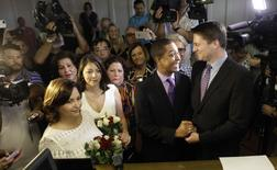 Same-sex couples Todd (2nd R), and Jeff Delmay with Catherina Pareto and Karla Arguello (L) get married at the Eleventh Judicial Circuit Court of Florida in Miami, Florida, January 5, 2015.   REUTERS/Javier Galeano
