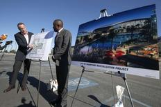 Hollywood Park Senior Vice President Chris Meany (L) and project manager Gerard McCallum display plans for development at the site of the former Hollywood Park Race Track at a news conference in Inglewood, Los Angeles, , January 5, 2015. REUTERS/Lucy Nicholson