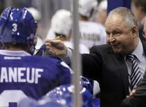 Oct 22, 2013; Toronto, Ontario, CAN; Toronto Maple Leafs head coach Randy Carlyle talks to defenseman Dion Phaneuf (3) during a break in the action against the Anaheim Ducks at the Air Canada Centre. Toronto defeated Anaheim 4-2. Mandatory Credit: John E. Sokolowski-USA TODAY Sports