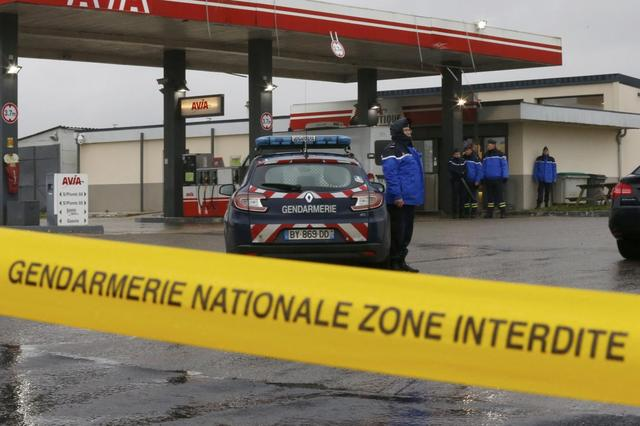 A Gendarmerie cordon is seen at a gas station in Villers-Cotterets, north-east of Paris, where armed suspects from the attack on French satirical weekly newspaper Charlie Hebdo were spotted in a car, January 8, 2015. REUTERS/Pascal Rossignol