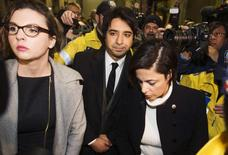 Jian Ghomeshi (C), a former celebrity radio host who has been charged with multiple counts of sexual assault, leaves court alongside his lawyer Marie Henein (R) in Toronto, January 8, 2015. REUTERS/Mark Blinch