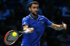 Marin Cilic of Croatia returns the ball during his men's singles tennis match against Stanislas Wawrinka of Switzerland at the ATP World Tour Finals at the O2 Arena in London November 14, 2014.  REUTERS/Stefan Wermuth/Files